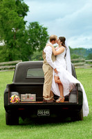 bride and groom in vintage truck